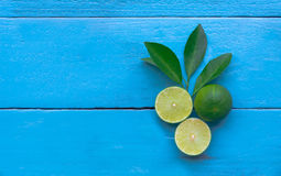the Lime lemon are half cut on blue wooden background. copy spac Royalty Free Stock Photo