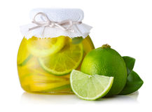 Lime and lemon jam with ripe fruits  on white Stock Photos