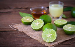 A Lime lemon with juice  and honey in transparent glass with sac Royalty Free Stock Images