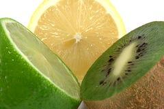Lime, lemon and kiwi. Isolated on white background Stock Images