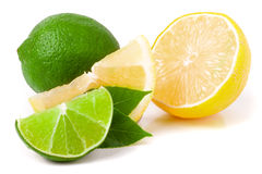 Lime and lemon with leaves isolated on white background Stock Images