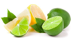 Lime and lemon with leaves isolated on white background Stock Photo
