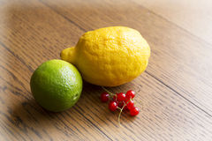 Lime, lemon, red currants Royalty Free Stock Photo