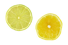 Lime and lemon slices. Closeup of lemon and lime slices over white Royalty Free Stock Image