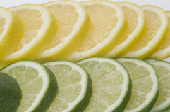 Lime with Lemon Slices. Slices of lemon next to slices of lime lined up Royalty Free Stock Image