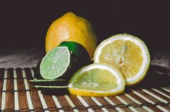 Lime and lemon splash with ice and some detox water. Food photo of fresh lime and lemons. This is perfect for background or magazines related to food and kitchen Stock Image