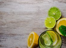 Lime and lemon splash with ice and some detox water. Food photo of fresh lime and lemons. This is perfect for background or magazines related to food and kitchen royalty free stock photo