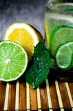 Lime and lemon splash with ice and some detox water. Food photo of fresh lime and lemons. This is perfect for background or magazines related to food and kitchen Stock Photo