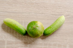 Lime lemon and two cucumbers like people cheers Royalty Free Stock Photos