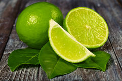 Lime 7. Limes on a wooden table Royalty Free Stock Photos