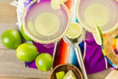 Lime margarita. Classic lime margarita with garnish lime and turbinado sugar for Fiesta Stock Photo
