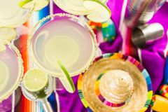 Lime margarita. Classic lime margarita with garnish lime and turbinado sugar for Fiesta Royalty Free Stock Images