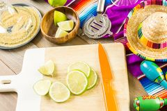 Lime margarita. Classic lime margarita with garnish lime and turbinado sugar for Fiesta Stock Images