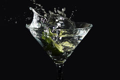 Lime Martini Splash. High speed picture of a lime falling into a martini Royalty Free Stock Photo