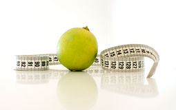 Lime measure. Lime with measure tape on a white background Royalty Free Stock Photo
