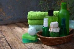 Lime mint composition beauty treatment products in green colors: shampoo, soap, bath salt, towel, oil. Various bath accessories. I Stock Photos