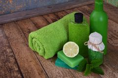 Lime mint composition beauty treatment products in green colors: shampoo, soap, bath salt, towel, oil. Various bath accessories. I Royalty Free Stock Image