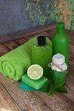 Lime mint composition beauty treatment products in green colors: shampoo, soap, bath salt, towel, oil. Various bath accessories. I stock images