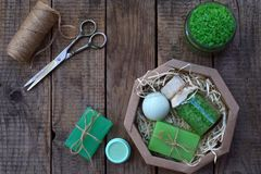 Lime mint composition beauty treatment products in green colors: shampoo, soap, bath salt, towel, oil. Various bath accessories. I Stock Image