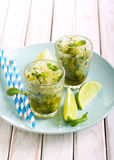 Lime and mint granita. In glasses on plate royalty free stock photos