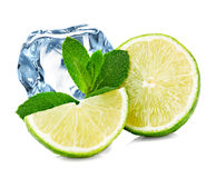 Lime, mint and ice cube Stock Images
