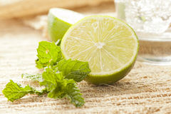 Lime and Mint Leaf next to a mojito Stock Photo