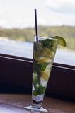Lime mint mojito on wooden table Royalty Free Stock Photo