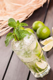 Lime Moijto cocktail with straw hat on a deck Royalty Free Stock Photos