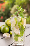 Lime Mojito cocktail close-up on a wooden table in garden Stock Photos