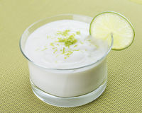 Lime Mousse in Glass Bowl on Green Background. Royalty Free Stock Photography
