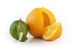 Lime and orange. With cutted out slice Royalty Free Stock Photography