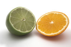 Lime and orange. Big slice of green lime and small orange Stock Image