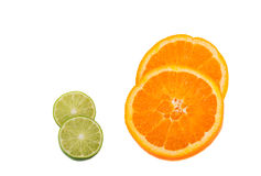 Lime and orange cut in half isolated on white Royalty Free Stock Photography