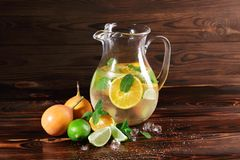 Lime, orange, mint - ingredients for a juice on a table background. A cocktail with rum, liquor and fruits. Copy space. Stock Photo
