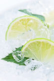 Lime and peppermint leaves Royalty Free Stock Photography