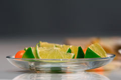 Lime and Physalis. Lime on the glass bowl Stock Photography