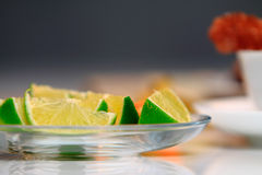 Lime and Physalis. Lime on the glass bowl Royalty Free Stock Photos