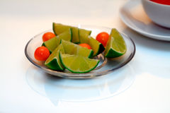 Lime and Physalis. Lime on the glass bowl Stock Image