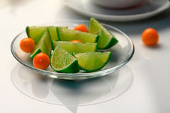 Lime and Physalis. Lime on the glass bowl Stock Images