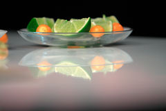 Lime and Physalis. Lime on the glass bowl Royalty Free Stock Photography