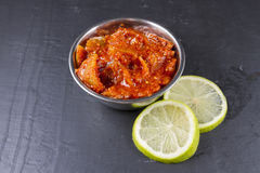 Lime pickle with lime slices on slate background Royalty Free Stock Image