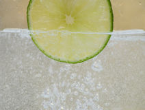 Lime. Piece of lime in the water Royalty Free Stock Photo