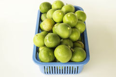 Lime in plastic baskets Stock Photos