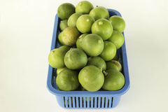Lime in plastic baskets Stock Image