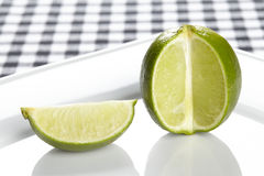 Lime on a plate. A single lime on a porcellain plate Stock Photo