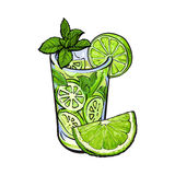 Lime quarter and glass of juice, mojito, cocktail with ice Royalty Free Stock Photo