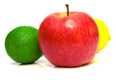 Lime, red apple and lemon. On white background. Isolation, shallow DOF Stock Photos