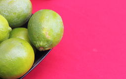 Lime on a red background Stock Photos