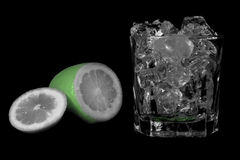 Lime on the rocks. Lime with a mug full of ice Stock Images