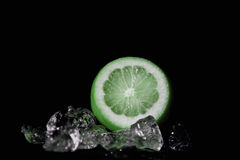 Lime on the rocks. Sliced lime with some ice cubes Stock Photo